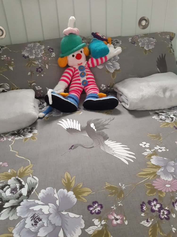 Clown reclining on bed