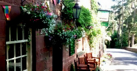 Picture of the outside of the Ship Inn at Wincle bathed in summer sunshine